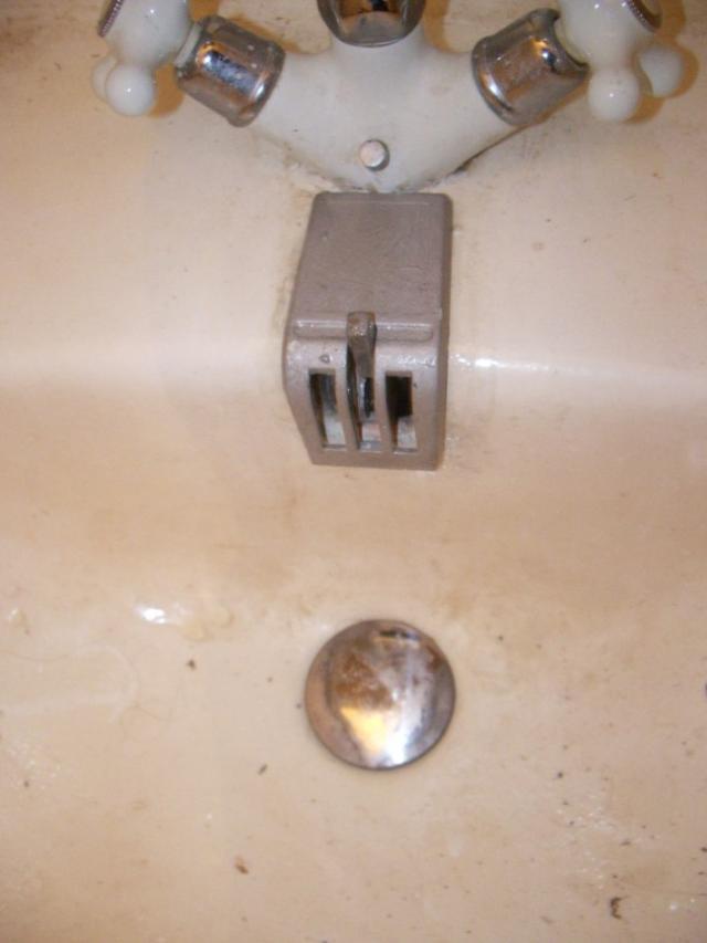 reparer le mecanisme de bonde sur lavabo ancien 17